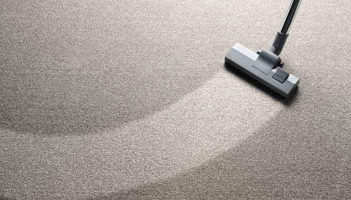 Vacuum cleaning the Floor